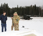 Chris Bailey, left, the U.S. Army Corps of Engineers Europe District project engineer in Estonia, briefs Col. John Baker, right, chief engineer for U.S. Army Europe, on newly constructed machine gun and sniper ranges built through the European Reassurance Initiative to enhance readiness of U.S., Estonian and NATO forces Dec. 14 at Tapa Training Area, Estonia.