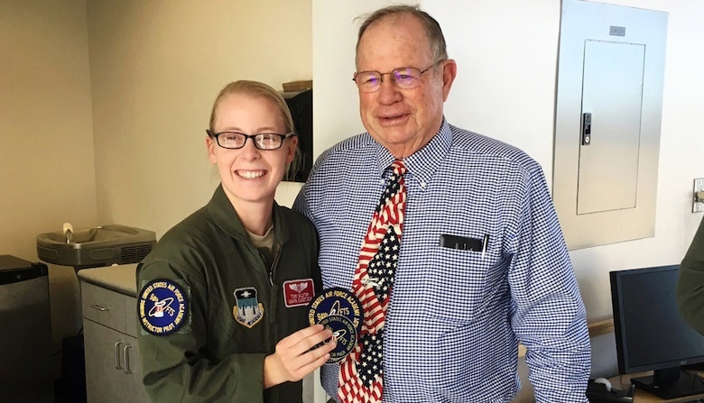 Cadet 2nd Class Tori Gilster and retired Lt. Col. Richard Trail, a graduate of the U.S. Air Force Academy, pose for a photo last fall in the 94th Flying Training Squadron offices. Trail was the first cadet to make a successful solo flight in a glider. He and retired Lt. Col. James Leland visited the Academy to meet cadets and staff and discuss the advances made in the wake of the Air Force's only Soaring Program. Leland helped design the Soaring Program in the 1960s.'(Courtesy photo)