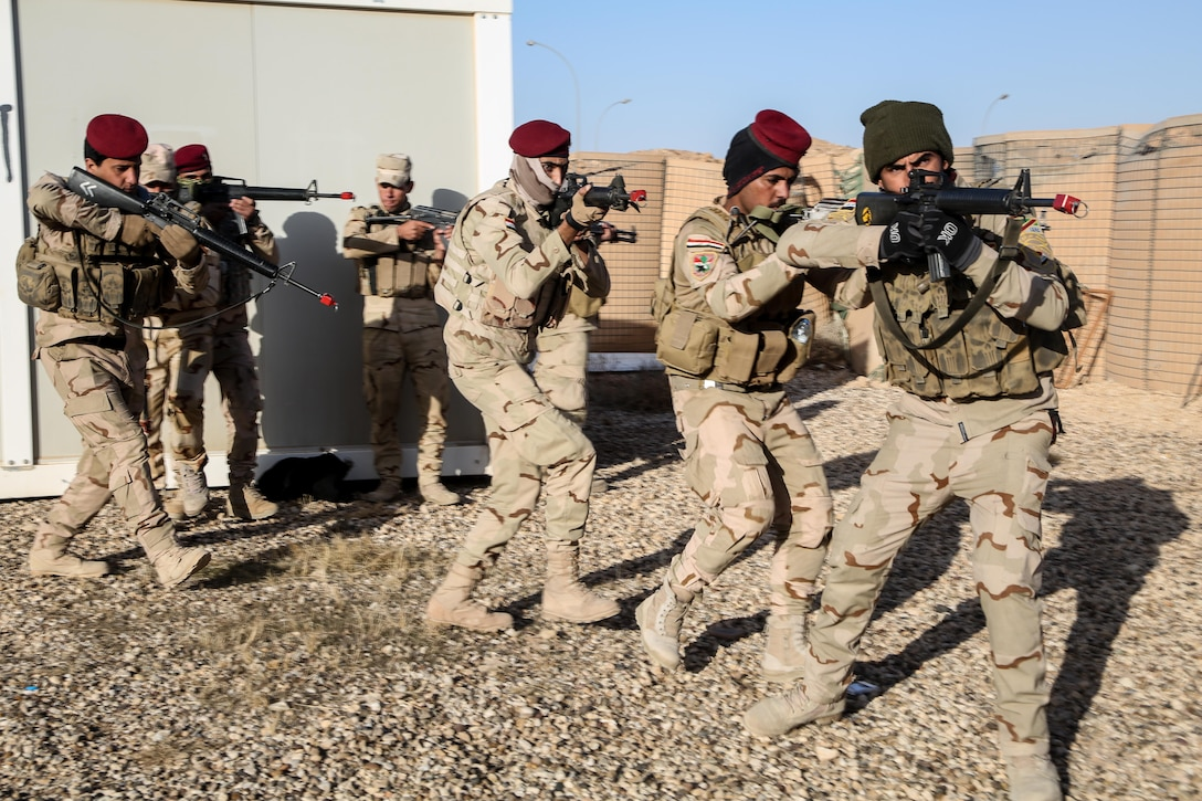 Iraqi soldiers from 7th Iraqi Army Division conduct squad movement drills during infantry squad training at Al Asad Air Base, Iraq, Jan. 14, 2017. Training at building partner capacity sites is an integral part of Combined Joint Task Force – Operation Inherent Resolve's effort to train Iraqi security forces personnel to defeat ISIL. CJTF-OIR is the global Coalition to defeat ISIL in Iraq and Syria. (U.S. Army photo by Sgt. Lisa Soy)
