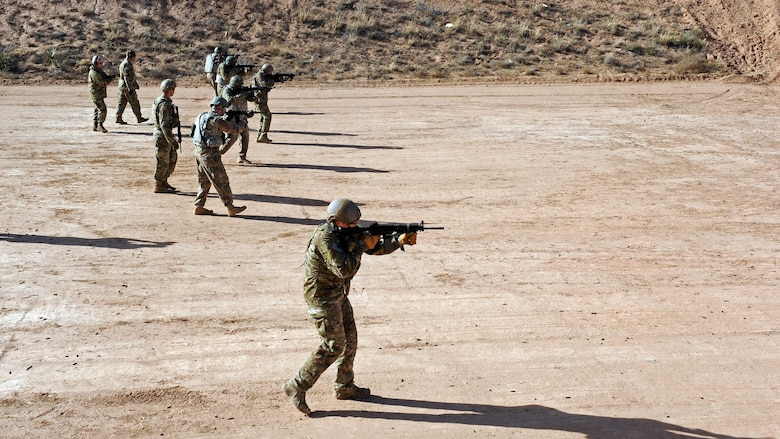 Airmen assigned to Cannon Air Force Base, N.M., participate in M-4 shooting drills during the Green Beret Experience, Dec. 12, 2016. Taught by U.S. Army Green Berets, the Green Beret Experience is a four-day event featuring weapons and ground operations training intended give Airmen an idea of what it's like to be a member of the Army's elite ground force. (U.S. Air Force photo by Staff Sgt. Whitney Amstutz/Unreleased)