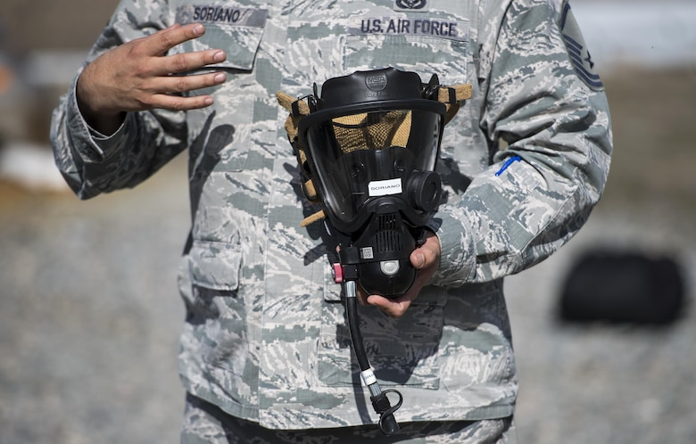 Master Sgt. Juan Soriano, 23d Civil Engineer Squadron explains why it's important to wear the right gear, during Vehicle Extrication training, Jan. 13, 2017, at Moody Air Force Base, Ga. Soriano explained that the gear is so advanced and durable that it will be affected by the fire before the firefighter feels anything. (U.S. Air Force photo by Airman 1st Class Janiqua P. Robinson)