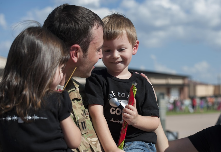 U.S. Air Force Capt. Joe Becker, 39th Airlift Squadron greets his family after returning from a deployment at Dyess Air Force Base, Texas, Sept. 19, 2016. Air Force Global Strike Command is dedicating 2017 to Airmen, their loved ones and the total force at large and will focus on areas that greatly affect their quality of life. These areas include they live, learn, play, pray and receive care. (U.S. Air Force photo by Airman 1st Class Rebecca Van Syoc)