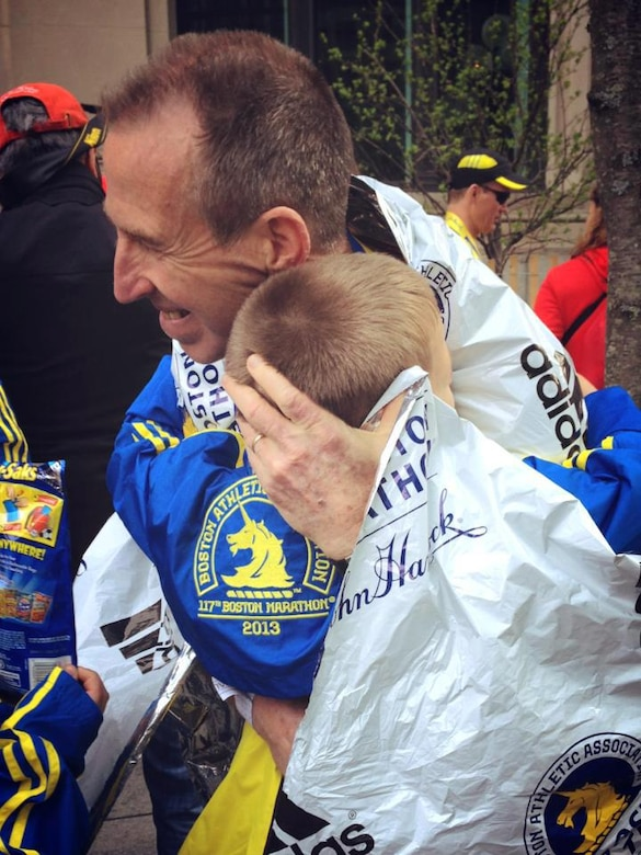 Dave Nickell, unit deployment manager with the 477th Fighter Group at Joint Base Elmendorf-Richardson, Alaska, embraces his family after completing his first Boston Marathon April, 2013, shortly before a bomb went of at the finish line. Nickell remembers the Boston Marathon tragedy of 2013 while training for the 2017 race.