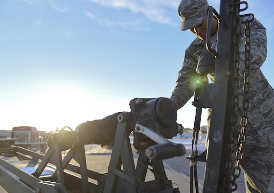 Airman 1st Class Christian Gray, an Aerial and Ground Equipment specialist assigned to the 28th Maintenance Squadron, locks the brake on a piece of equipment, Jan. 17, 2017, at Ellsworth Air Force Base, S.D. In two days, Airmen from the Logistics Readiness Squadron and the 28th LRS Travel Management Office loaded approximately 321k pounds of equipment to be used at Red Flag—an Air Force-wide exercise testing air-to-air combat. (U.S. Air Force photo by Airman 1st Class Randahl J. Jenson)
