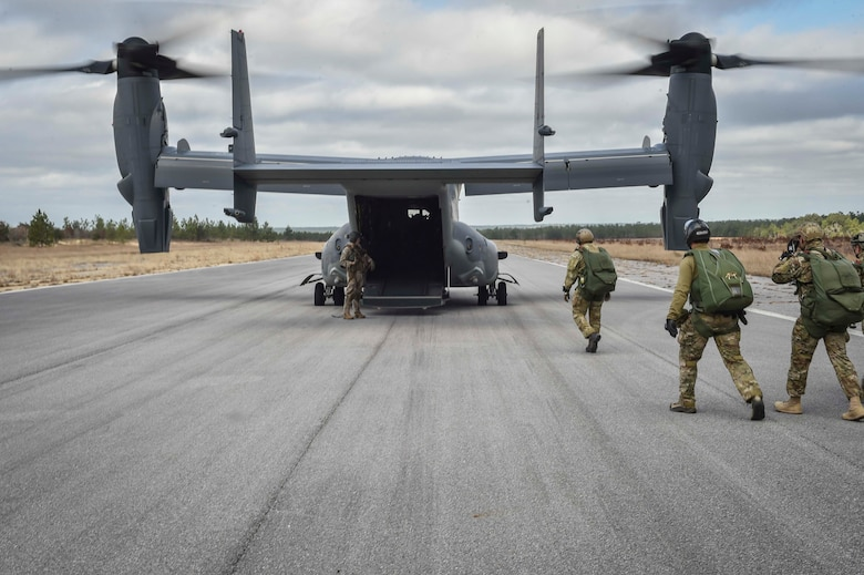 Special Tactics members board a CV-22 Osprey for Chief Master Sgt. Davide Keaton's, 26th Special Tactics Squadron superintendent, final military free fall at Eglin Range, Fla., Jan. 10, 2017. Over the course of Keaton's 30-year career, he was decorated nine times for actions that saved dozens -- if not hundreds-- on and off the battlefield. (U.S. Air Force photo by Senior Airman Ryan Conroy)