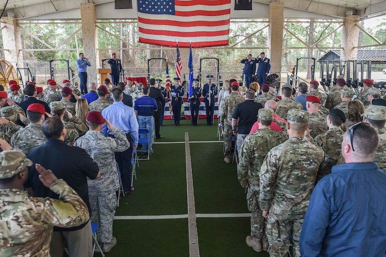 A hundred teammates, friends and family members salute the National Anthem during Chief Master Sgt. Davide Keaton's, superintendent of the 26th Special Tactics Squadron, retirement ceremony at Hurlburt Field, Fla., Jan. 12, 2017. Over the course of Keaton's 30-year career, he was decorated nine times for actions that saved dozens -- if not hundreds-- on and off the battlefield. (U.S. Air Force photo by Senior Airman Ryan Conroy)