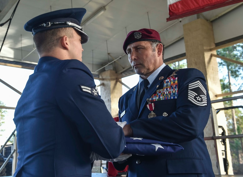 Chief Master Sgt. Davide Keaton, 26th Special Tactics Squadron superintendent, receives a folded flag from the Hurlburt Field Honor Guard during his retirement ceremony at Hurlburt Field, Fla., Jan. 12, 2017. Keaton served in the Air Force for 30 years as a law enforcement specialist and pararescueman. (U.S. Air Force photo by Senior Airman Ryan Conroy)