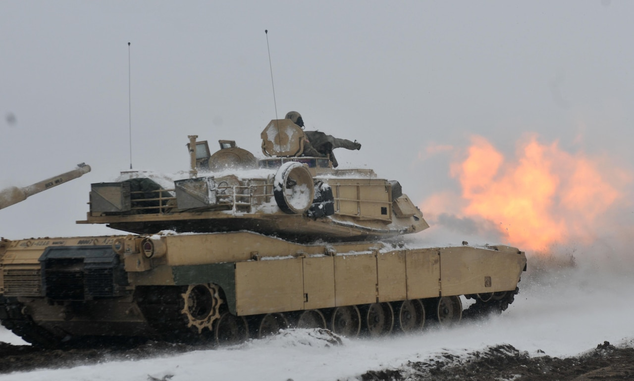 A round is fired from a U.S. Army M1A2 tank belonging to 1st Battalion, 68th Armor Regiment, 3rd Armored Brigade Combat Team, 4th Infantry Division, during the first Live Fire Accuracy Screening Tests at Presidential Range in Swietozow, Poland, January 16, 2017. The arrival of 3rd Arm. Bde. Cmbt. Tm., 4th Inf. Div., marks the start of back-to-back rotations of armored brigades in Europe as part of Atlantic Resolve. The vehicles and equipment, totaling more than 2,700 pieces, were shipped to Poland for certification before being deployed across Europe for use in training with partner nations. This rotation will enhance deterrence capabilities in the region, improve the U.S. ability to respond to potential crises and defend allies and partners in the European community. U.S. forces will focus on strengthening capabilities and sustaining readiness through bilateral and multinational training and exercises. (Photo by Staff Sgt. Elizabeth Tarr)