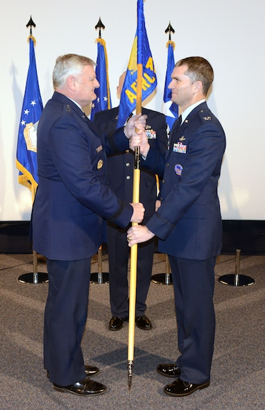 Maj. Gen. William B. Waldrop Jr., vice commander, Air Force Reserve Command passes leadership of AFRC Recruiting Service to Col. Harold W. Linnean III, in a ceremony held at Robins Air Force Base, Georgia. (Air Force photo/Master Sgt. Chance Babin)