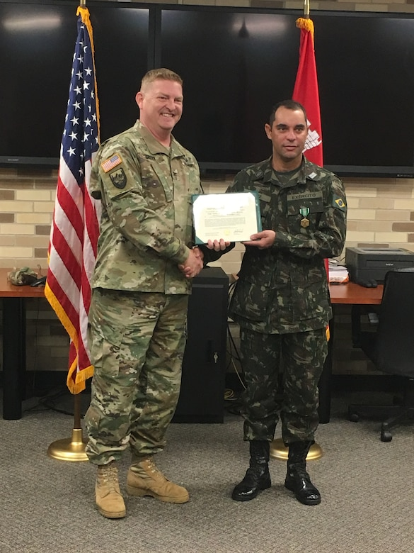 At his farewell ceremony in December, Lt. Col. Nilber Cruz was presented an Army Commendation Medal by ERDC's Commander Col. Bryan Green for meritorious service while displaying exceptional leadership and technical excellence while working on numerous research projects at ERDC.