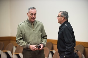 Marine Corps Gen. Joe Dunford, chairman of the Joint Chiefs of Staff, speaks with Army Gen. Curtis M. Scaparrotti, Supreme Allied Commander Europe, before trilateral talks with Turkish Chief of Defense Gen. Hulusi Akar at NATO Headquarters in Brussels, Jan. 17, 2017. The two men were participating in the alliance Military Committee meeting. DoD photo by Army Sgt. James K. McCann
