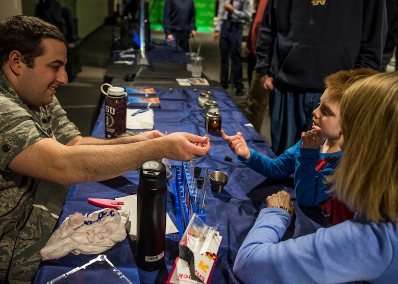 Capt. Nicholas Littman, 375th Aerospace Medicine Squadron, teaches visitors how to extract DNA from a strawberry.  (U.S. Air Force photo by Staff Sgt. Jodi Martinez)