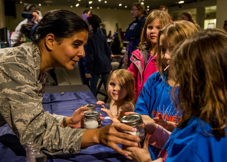 Maj. Anita Shade, 375th Dental Squadron residency director, shows the effects of acid on eggs, much like the effects of acid on teeth during the event. (U.S. Air Force photo by Staff Sgt. Jodi Martinez)