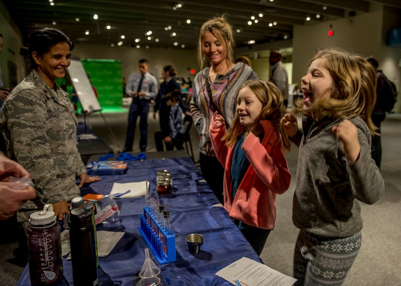 Girls react to learning about the effects of acid on teeth. (U.S. Air Force photo by Staff Sgt. Jodi Martinez)
