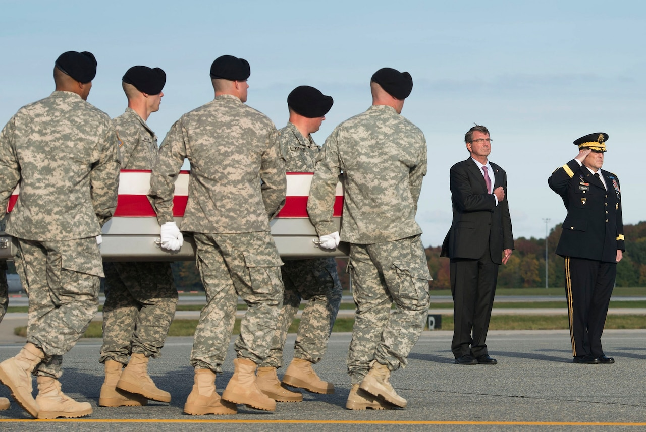 Defense Secretary Ash Carter and Army Chief of Staff Gen. Mark A. Milley render honors as an Army carry team moves the transfer case of Army Master Sgt. Joshua L. Wheeler during a dignified transfer ceremony at Dover Air Force Base, Del., Oct. 24, 2015. Wheeler was fatally wounded aiding Kurdish peshmerga fighters during a hostage-rescue mission in Iraq. DoD photo by Air Force Senior Master Sgt. Adrian Cadiz