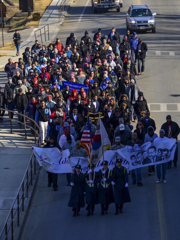 Team Osan members march in the first Rev. Dr. Martin Luther King, Jr., Memorial March at Osan Air Base, Republic of Korea, Jan. 16, 2017. The march was the first organized Martin Luther King Jr. Day march in the history of Osan Air Base. (U.S. Air Force photo by Senior Airman Victor J. Caputo)