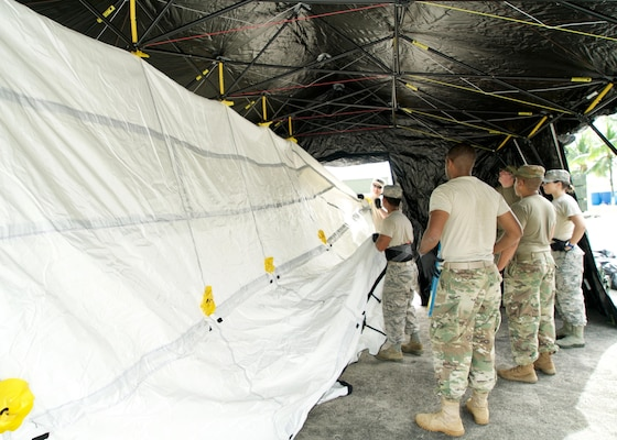 A joint team of U.S. Airmen and Soldiers attach an interior liner to a Base-X Shelter, Clark Air Base, Philippines, Jan. 15, 2017. The shelter will house an Eagle Vision Data Integration Segment. Eagle Vision is a ground-based commercial satellite imagery system. While in the Philippines, the team of U.S. service members will exchange ideas and experiences with their Philippine allies on how the Eagle Vision system can enhance Humanitarian Assistance and Disaster Relief capabilities.(U.S. Air Force photo by Tech. Sgt. James Stewart/Released)