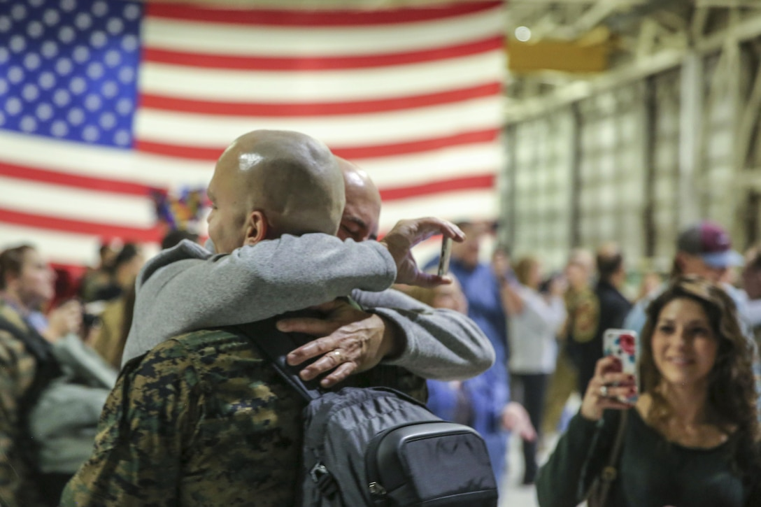 Marine Corps Sgt. Nicholas Christopoulas reunites with his family at Marine Corps Air Station Cherry Point, N.C., Jan. 17, 2017, after a seven-month deployment. Christopoulas is a fixed-wing safety equipment mechanic assigned to Marine Attack Squadron 542. Marine Corps photo by Lance Cpl. Cody Lemons