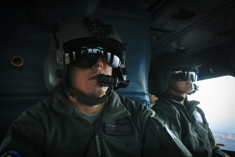 Tech. Sgt. Michael Wright, 459th Airlift Squadron special mission aviator evaluator, left, and Lt. Col. Valerie Johnson, 374th Medical Group aerospace medicine chief, sit in a UH-1N Iroquois during a training mission flying over the Kanto Plains, Japan, Jan. 13, 2017. During the scenario, the aircrew performed an alternate insertion of crew members, hoist insertion and extraction from 25-35 feet above ground, and proper landing and takeoff techniques throughout various landing zones. (U.S. Air Force photo by Staff Sgt. David Owsianka)