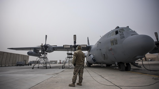 Staff Sgt. Kyle Poston, 455th Expeditionary Aircraft Maintenance Squadron crew chief, oversees engine maintenance on an EC-130 Compass Call Jan. 18, 2017 at Bagram Airfield, Afghanistan. To date, 41st EECS crews have flown over 39,000 hours during 6,800 combat sorties in support of Operation Enduring Freedom, and now the Resolute Support Mission. (U.S. Air Force photo by Staff Sgt. Katherine Spessa)