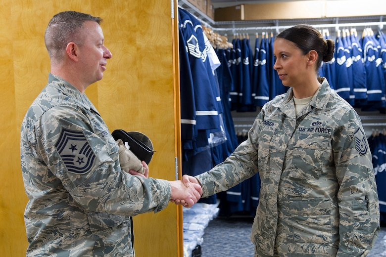 Chief Master Sgt. Brendan Criswell, Air Force Space Command command chief, meets with Master Sgt. Jessica Skinner, 45th Force Support Squadron NCO in charge of Honor Guard, during his visit Jan. 13, 2017, at Patrick Air Force Base, Fla. The Patrick Air Force Base Honor Guard's mission here is to provide military funeral honors for active duty members, retirees and veterans. (U.S. Air Force photo by Matthew Jurgens)