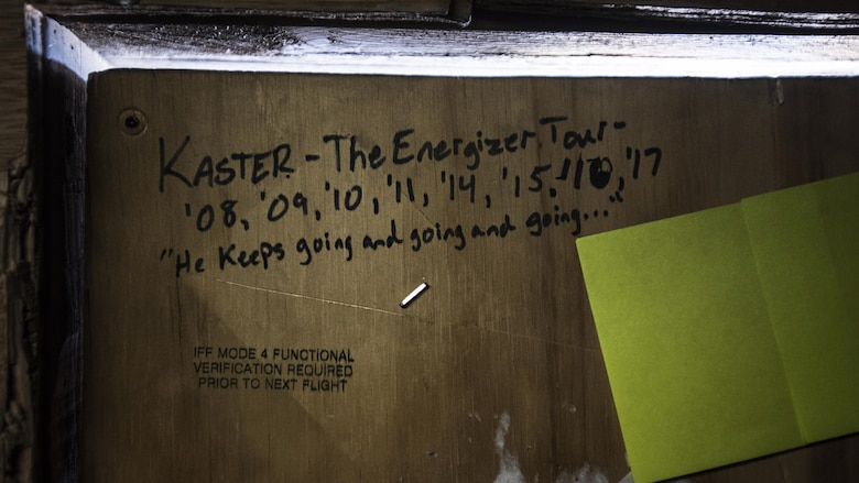 A list of deployment dates for Tech. Sgt. Bob Kaster, 455th Expeditionary Aircraft Maintenance Squadron C-130 Compass Call Aircraft Maintenance Unit communications navigations and mission systems technician, is written on the door of his office at Bagram Airfield, Afghanistan Jan. 12, 2017. The 41st Electronic Combat Squadron and the 755th Aircraft Maintenance Squadron based out of Davis-Monthan Air Force Base, Arizona, have been continuously deployed in support of Operation Enduring Freedom, and now Resolute Support Mission, since 2002. They have been at Bagram since 2004. (U.S. Air Force photo by Staff Sgt. Katherine Spessa)