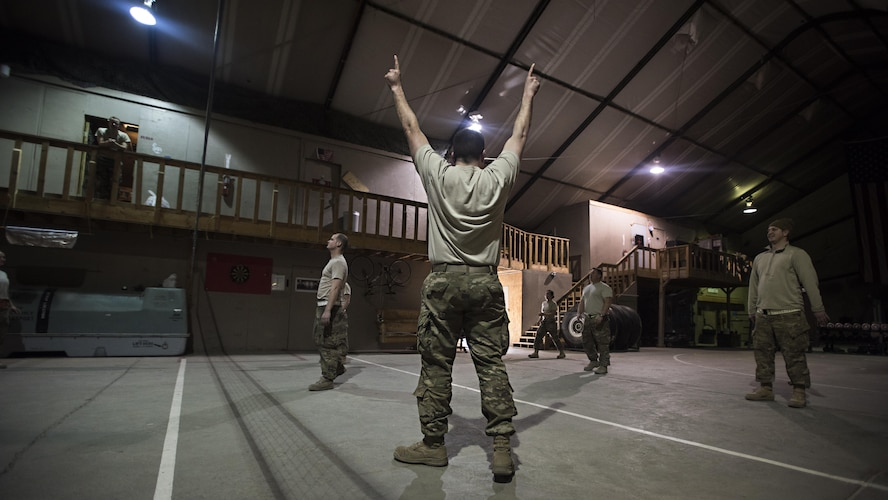 Senior Master Sgt. Scott Conner, 455th Expeditionary Aircraft Maintenance Squadron C-130 Compass Call Aircraft Maintenance Unit superintendent, cheers after his team scored in a volleyball game at Bagram Airfield, Afghanistan Jan. 12, 2017. Individuals throughout the AMU often have deployments in the double digits, with months out of each year spent away from home. (U.S. Air Force photo by Staff Sgt. Katherine Spessa)