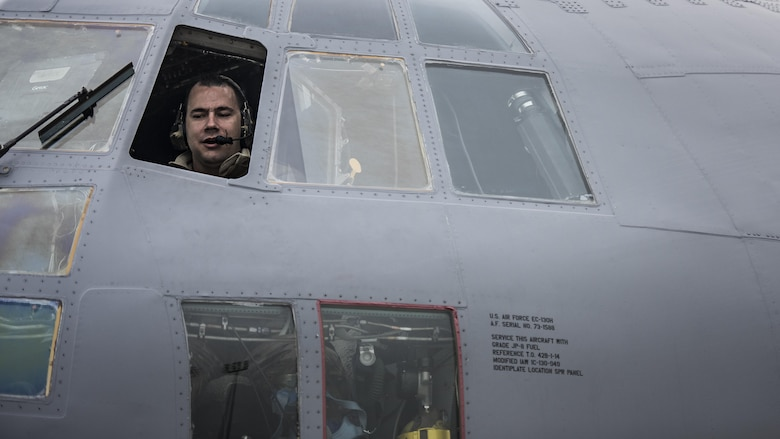 Tech. Sgt. Tony Rivera, 455th Expeditionary Aircraft Maintenance Squadron crew chief, sits in the cockpit of an EC-130 Compass Call Jan. 18, 2017 at Bagram Airfield, Afghanistan. The members of the 455th EAMXS's EC-130 aircraft maintenance unit currently deployed to Bagram Airfield, Afghanistan have 146 deployments among them. (U.S. Air Force photo by Staff Sgt. Katherine Spessa)