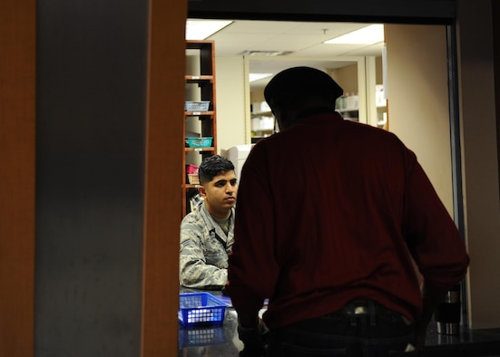 U.S. Air Force Senior Airman Sudeep Jacob, 19th Medical Group pharmacy technician, caters to a customer's needs Jan. 12, 2017, at the 19th MDG pharmacy on Little Rock Air Force Base, Ark. The pharmacy assists more than 500 patients daily. (U.S. Air Force photo by Airman 1st Class Grace Nichols)