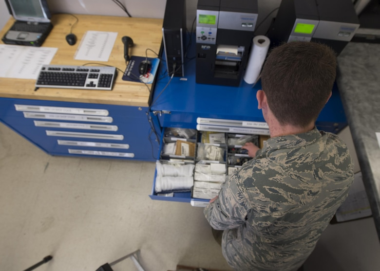 Airman Phillip Tashash, a 49th Maintenance Squadron munitions specialist, searches through asset drawers that are inventoried by the Ammo flight's new Automated Supply Accountability Program, Jan. 9, 2017, at Holloman Air Force Base, N.M. The ASAP is a new program that Holloman's Ammo flight uses to track quantity and prices of assets. Tashash created the program, which allows personnel to perform accurate transactions in 10 seconds, rather than five minutes with the old system. (U.S. Air Force photo by Senior Airman Emily Kenney)