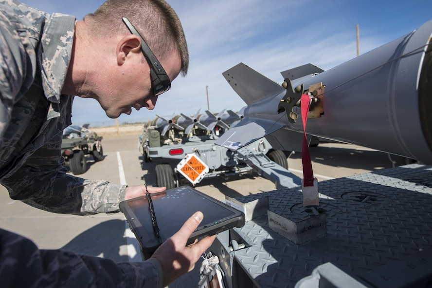 Staff Sgt. Joshua Tobin, a 49th Maintenance Squadron Munitions storage crew chief, uses a Getac tablet to scan a barcode on an asset, Jan. 9, 2017 at Holloman Air Force Base, N.M. The tablets are in the implementation phase, and are able to input information in real-time, significantly cutting down job times. (U.S. Air Force photo by Senior Airman Emily Kenney)