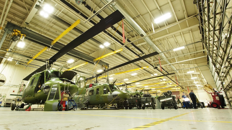 UH-1N Iroquois line the 54th Helicopter Squadron maintenance hangar at Minot Air Force Base, N.D., Jan. 18, 2017. Maintenance on 54th Helicopter Squadron's fleet is critical, in order to provide support to 91st Missile Wing Airmen and assets in the missile complex. (U.S. Air Force photo/Airman 1st Class J.T. Armstrong)
