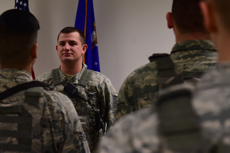 Staff Sgt. Bryce Neff, 460th Security Forces Squadron flight chief, debriefs Airmen coming off duty during shift change Jan. 13, 2017, on Buckley Air Force Base, Colo. Neff was highlighted by Col. David Miller Jr., 460th Space Wing commander, for his exceptional performance with ensuring Installation Readiness through numerous exercises and assessments.