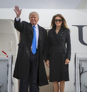 President-Elect Donald Trump waves to a crowd, alongside his wife, Melania Trump, as they depart an aircraft at Joint Base Andrews, Md., Jan. 19, 2017. Trump arrived here in preparation for the 58th Presidential Inauguration, Jan. 20, where he will take the oath as the President of the United States. (U.S. Air Force photo by Airman 1st Class Gabrielle Spalding)