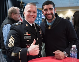 Army Command Sgt. Maj. John W. Troxell, senior enlisted advisor to the chairman of the Joint Chiefs of Staff, and Medal of Honor recipient Florent Groberg pose for a photo during the Medal of Honor Foundation reception prior to the 2016 Military Bowl at Navy-Marine Corps Memorial Stadium in Annapolis, Md., Dec. 27, 2016. DoD photo by Army Sgt. James K. McCann