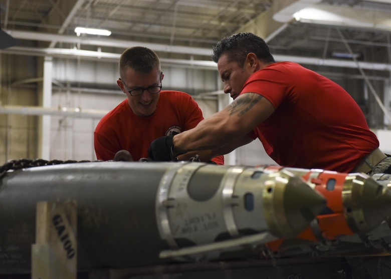U.S. Air Force Airman 1st Class Zachary Frana, a weapons load crew 4-member assigned to the 393rd Aircraft Maintenance Unit, left, and Tech. Sgt. Ricardo Zuniga, a weapons load crew team chief assigned to the 131st Aircraft Maintenance Squadron, inspect 4 GBU-38s, a 500 lb. class guided weapon, during a fourth quarter load competition at Whiteman Air Force Base, Mo., Jan. 6, 2017. Crews are required to complete the load in 45 minutes or less.