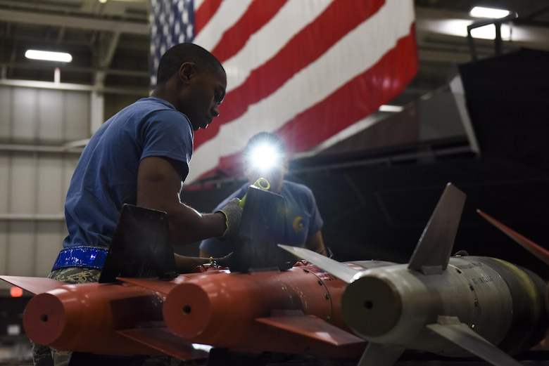 U.S. Air Force Airman 1st Class Chase Davis, a weapons load crew 3-member assigned to the 13th Aircraft Maintenance Unit, examines a GBU-38 during the fourth quarter load competition at Whiteman Air Force Base, Mo., Jan. 6, 2017. Every three months the most proficient crews from each aircraft maintenance unit within the 509th and 131st Aircraft Maintenance Squadrons compete for the Load Crew of the Quarter award.