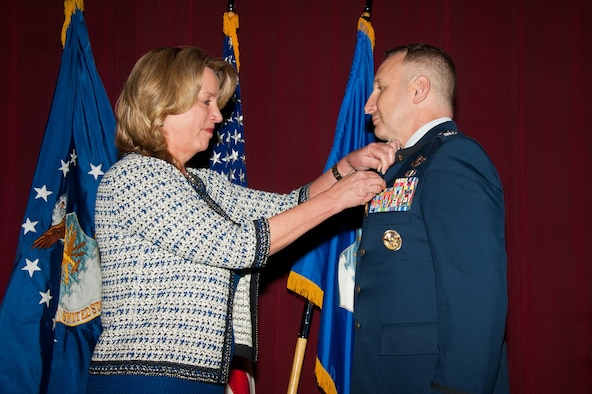 Air Force Secretary Deborah Lee James presents Col. Christopher C. Barnett, an Air War College faculty member, the Silver Star and the Silver Star first oak leaf cluster Jan. 19, 2017. James chose her last day as the secretary of the Air Force to honor Barnett for his gallantry in connection with 2009 military operations, as well as to announce upgraded medals awarded to seven additional Airmen. (US Air Force photo/Melanie Rodgers Cox)