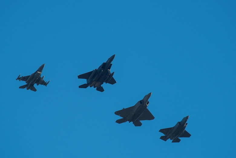 A 335th Fighter Squadron F-15E Strike Eagle conducts practice runs, Jan. 19, 2017, over the skies of Seymour Johnson Air Force Base, North Carolina, for the official U.S. Air Force aircraft fly-over of the 58th Presidential Inauguration. A four-ship formation including the 335th FS F-15E Strike Eagle; a 94th FS F-22 Raptor from Langley AFB, Virginia; a 58th FS F-35 Lightning II from Eglin AFB, Florida; and a 55th FS F-16 Fighting Falcon from Shaw AFB, South Carolina, will complete the fly-over during President-Elect Donald Trump's inauguration ceremony, Jan. 20, 2017. (U.S. Air Force photo by Airman Shawna L. Keyes)