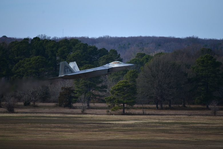 An F-22 Raptor takes off to perform a practice run for the inauguration flyover at Joint Base Langley-Eustis, Va, Jan. 19, 2017.The fighter jets are scheduled to fly in a close formation during the inauguration of President-elect Donald J. Trump at the Capitol in Washington, District of Columbia, Jan. 20, 2017. (U.S. Air Force photo by Airman 1st Class Tristan Biese)