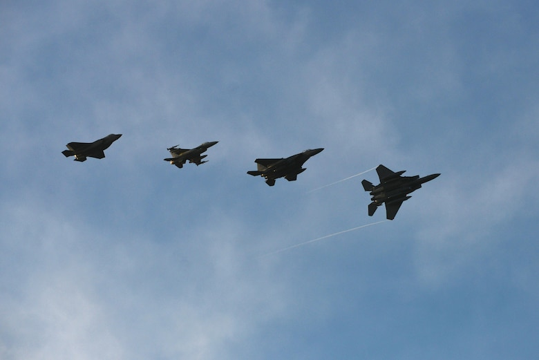 Four U.S. Air Force fighter jets practice for the inauguration flyover at Joint Base Langley-Eustis, Va., Jan. 19, 2017. The formation is comprised of two, fourth generation fighters (F-15 and F-16) along with two, fifth generation fighters (F-22 and F-35). (U.S. Air Force photo by Airman 1st Class Tristan Biese)