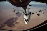 An Air Force E-3 Sentry refuels from a 340th Expeditionary Air Refueling Squadron KC-135 Stratotanker over Iraq, Jan. 18, 2017. The squadron extended the fight against the Islamic State of Iraq and the Levant by delivering fuel to the Sentry and Air Force F-16 Fighting Falcons. Air Force photo by Senior Airman Jordan Castelan