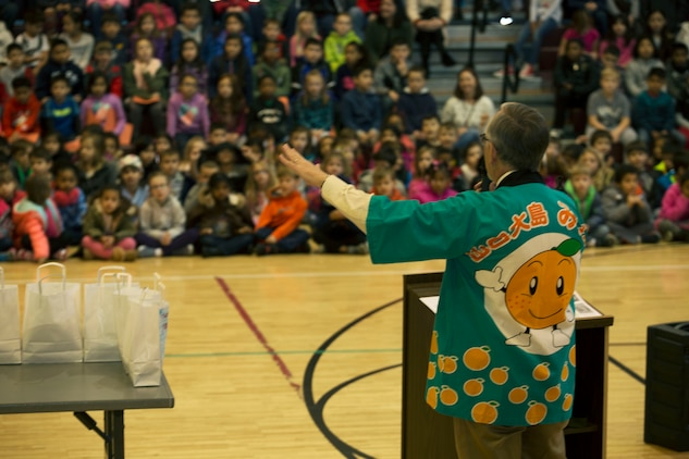 Larry Wahl, the psychologist for Matthew C. Perry Schools, adresses elementary school students during the seventh annual mikan presentation at Marine Corps Air Station, Iwakuni, Japan, Jan. 19, 2017. Local farmers presented the sweet, easy-to-peel citrus fruit, which is similar to Mandarin oranges, to students expanding their experience of Japanese cultures. (U.S. Marine Corps photo by Lance Cpl. Gabriela Garcia-Herrera)