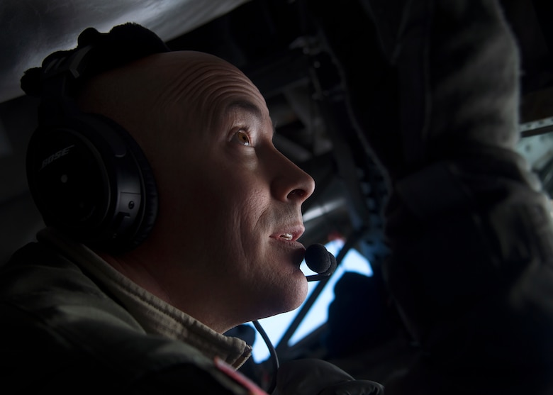 U.S. Air Force Master Sgt. Eric Jones, boom operator assigned to the 134th Air Refueling Wing, Tennessee Air National Guard, refuel 13th and 14th Fighter Squadron F-16 Fighting Falcon's over Northern Japan, Jan. 18, 2017. Boom operators refuel various types of aircraft in midair, extending the amount of time spent on training or combat missions. (U.S. Air Force photo by Senior Airman Deana Heitzman)
