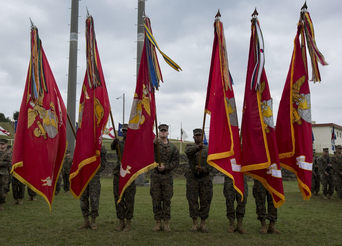 U.S. Marines carry the Marine Corps colors during a change of command ceremony for 3rd Marine Division on Camp Courtney, Okinawa, Japan, Jan. 20, 2017. Maj. Gen. Richard L. Simcock II relinquished command to Maj. Gen. Craig Q. Timberlake.