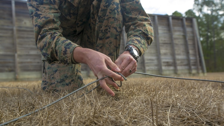 Sgt. Keith Lowe ties a knot of detonating cord while conducting a low-order demolition range at Camp Lejeune, N.C., Jan. 17th, 2017. The range was conducted to enable the Marines to be more capable of detonating unexploded ordnance without releasing shrapnel. Lowe is an explosive ordnance technician with 2nd Explosive Ordnance Disposal Company S.