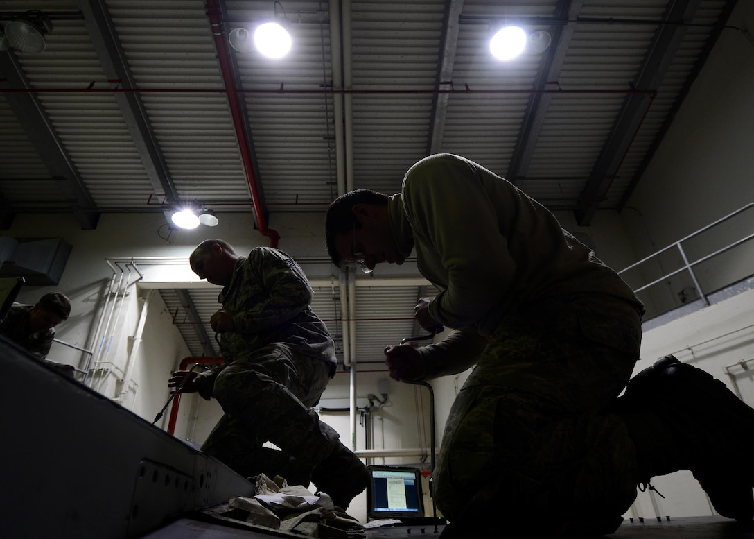 Airmen from the 31st Maintenance Squadron Aircraft Fuel Systems flight remove panels on an F-16 Fighting Falcon at Aviano Air Base, Italy on Jan. 18, 2017. After panels are removed, Airmen examine the structure of the internal fuel lines for any cracks or leaks. (U.S. Air Force photo by Senior Airman Cary Smith)