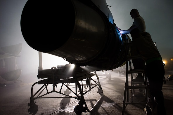 A 380th Expeditionary Aircraft Maintenance Squadron crew repairs an E-3 Sentry (AWACS) engine at an undisclosed location in Southwest Asia, Jan. 12, 2017. (U.S. Air Force photo/Senior Airman Tyler Woodward)