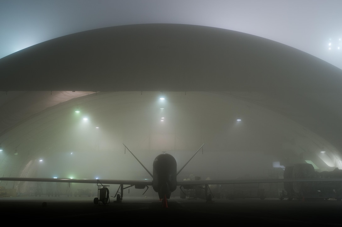 An RQ-4 Global Hawk awaits standard maintenance while a heavy fog rolls across the 380th Air Expeditionary Wing flightline at an undisclosed location in Southwest Asia, Jan. 12, 2017. Global Hawks have provided coalition partners with accurate intelligence necessary for precisely striking important Islamic State of Iraq and the Levant facilities and supply routes in support of Combined Joint Task Force-Operation Inherent Resolve. (Courtesy photo)