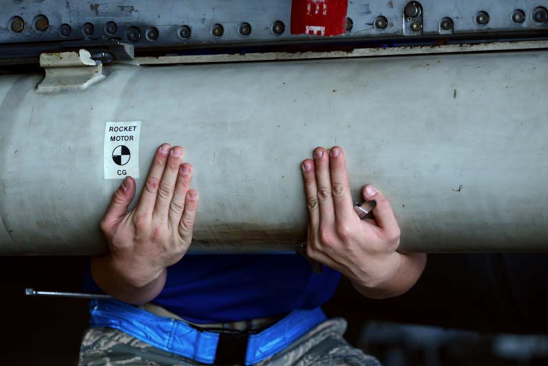Senior Airman Brandon Atwell, a 20th Aircraft Maintenance Squadron weapons loadcrew member, shakes an AGM-88 high-speed, anti-radiation missile loaded onto an F-16CM Fighting Falcon at Shaw Air Force Base, S.C., Jan. 13, 2017. By shaking the munition, Atwell ensured the munition was properly attached on its rail. (U.S. Air Force photo/Airman 1st Class Kathryn R.C. Reaves)